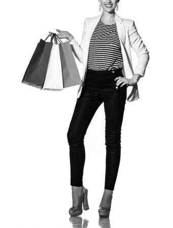 blackwhite: Shopping. The French way. Closeup on smiling young woman with French flag colours shopping bags posing against white background