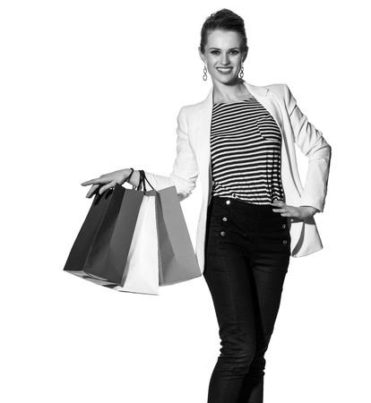 Einkaufen. Der französische Weg Ganzaufnahme der glücklichen jungen Frau mit französischer Flagge färbt die Einkaufstaschen, die auf weißem Hintergrund aufwerfen Standard-Bild - 75447908