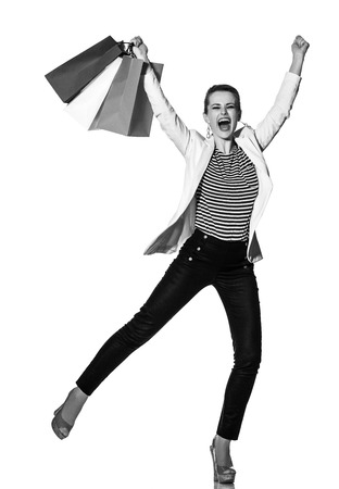 Shopping. The French way. Full length portrait of happy young woman with French flag colours shopping bags on white background rejoicing