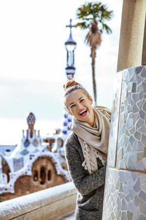 Barcelona signature style. happy trendy traveller woman in Barcelona, Spain in the winter having fun time
