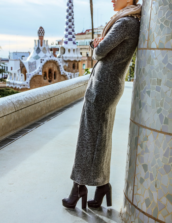 Barcelona signature style. Closeup on modern tourist woman standing at Guell Park in Barcelona, Spain in the winter