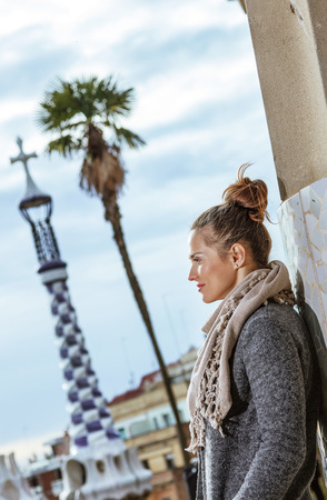 Barcelona signature style. pensive stylish tourist woman at Guell Park in Barcelona, Spain in the winter exploring attractions