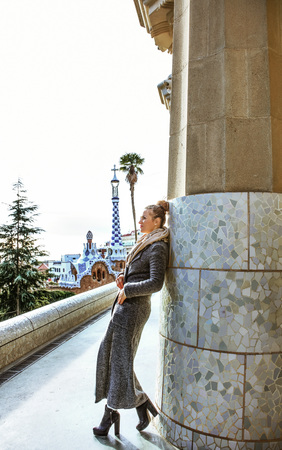 Barcelona signature style. Full length portrait of trendy tourist woman in Barcelona, Spain in the winter sightseeing Stock Photo