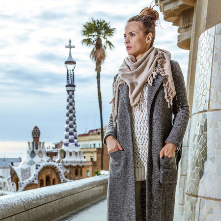 Barcelona signature style. Full length portrait of young woman  at Guell Park in Barcelona, Spain in the winter