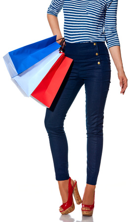 Shopping. The French way. Closeup on modern woman with shopping bags of the colours of the French flag isolated on white Stock Photo