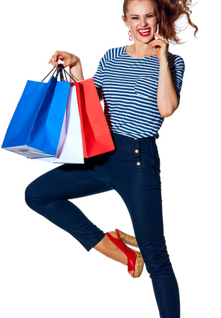 Shopping. The French way. cheerful stylish fashion-monger with shopping bags of the colours of the French flag isolated on white posing Stock Photo