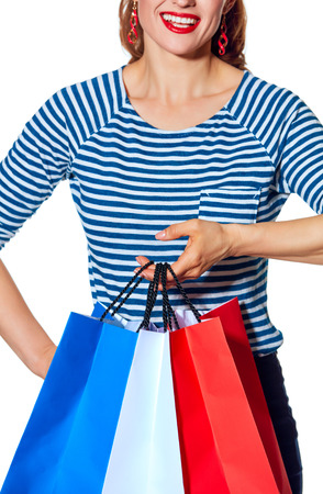 Shopping. The French way. Closeup on happy stylish fashion-monger with shopping bags of the colours of the French flag isolated on white background Stock Photo
