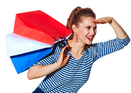 Shopping. The French way. smiling stylish woman with shopping bags of the colours of the French flag isolated on white background looking into the distance