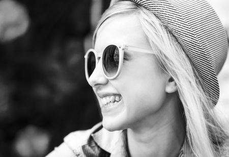 Portrait of smiling young hipster outdoors