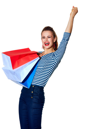 Shopping. The French way. young fashion-monger with shopping bags of the colours of the French flag isolated on white background rejoicing Stock Photo