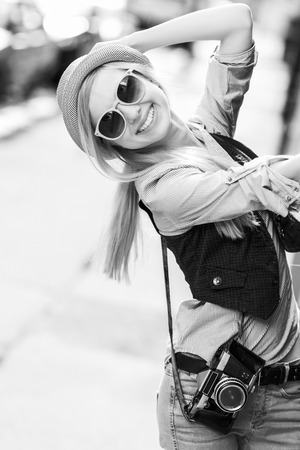 Portrait of young hipster in the city having fun