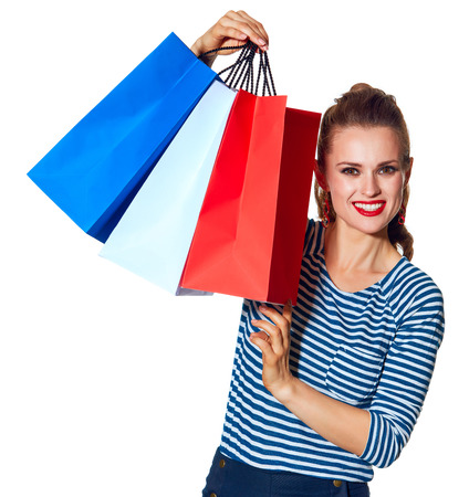 Shopping. The French way. Portrait of modern woman with shopping bags of the colours of the French flag isolated on white