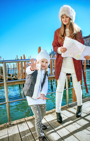 Another world vacation. smiling modern mother and daughter tourists in Venice, Italy in the winter having fun time Stock Photo