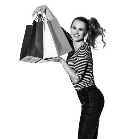 norway flag: Shopping. The French way. Full length portrait of happy stylish fashion-monger showing shopping bags of the colours of the French flag isolated on white