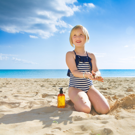 sunbath: Sun kissed beauty. healthy child in beachwear on the seashore having fun time Stock Photo