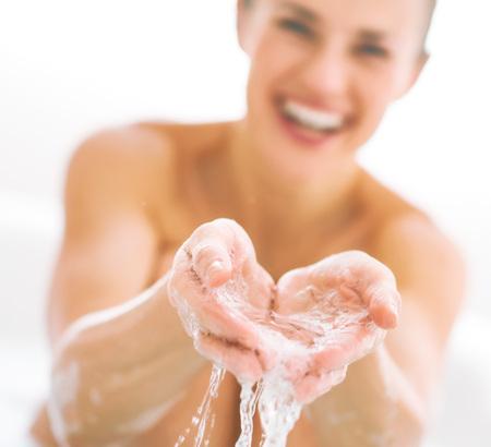 Closeup on smiling young woman splashing water Stock Photo