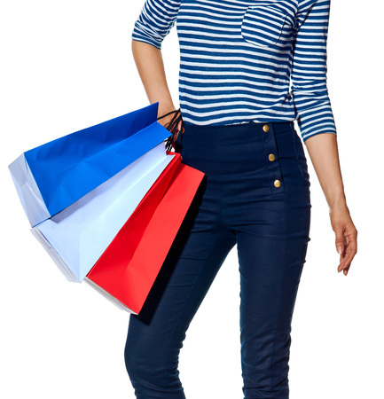 materialism: Shopping. The French way. Closeup on modern woman with shopping bags of the colours of the French flag isolated on white Stock Photo