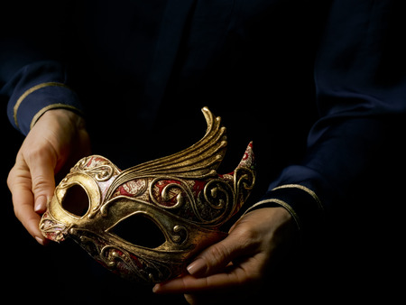 Black Mania. woman hands isolated on black showing Venetian mask