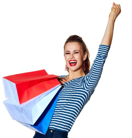 Boodschappen doen. De Franse manier. jonge mode-monger met boodschappentassen van de kleuren van de Franse vlag geïsoleerd op witte achtergrond vreugde