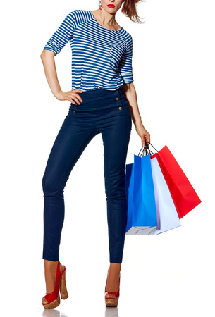 materialism: Shopping. The French way. Closeup on stylish fashion-monger with shopping bags of the colours of the French flag standing isolated on white background Stock Photo