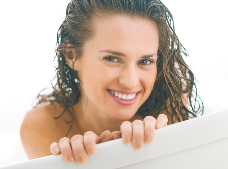 young woman looking out from bathtub