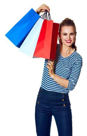 Shopping. De Franse manier. Portret van de moderne vrouw met boodschappentassen van de kleuren van de Franse vlag op wit wordt geïsoleerd