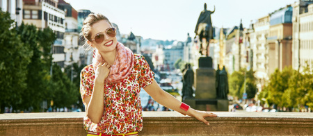 The spirit of old Europe in Prague. Portrait of happy modern woman on Vaclavske namesti in Prague, Czech Republic