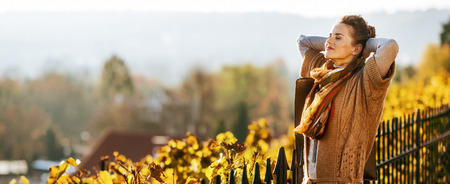 Portrait of relaxed young woman in autumn outdoors Stok Fotoğraf