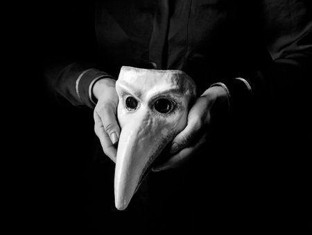 Black Mania. woman hands isolated on black background showing Venetian mask Stock Photo
