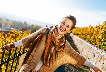 Portrait of happy young woman in autumn outdoors Фото со стока