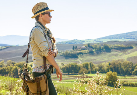 Discovering magical views of Tuscany. healthy woman hiker with bag hiking in Tuscany looking into the distance 版權商用圖片