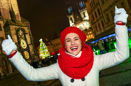 Magic on streets of the old town at Christmas. smiling modern tourist woman in red hat and scarf at Christmas in Prague Czech Republic rejoicing