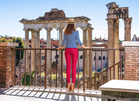 Roman Holiday. Full length portrait of elegant woman in the front of Roman Forum in Rome, Italy exploring attractions