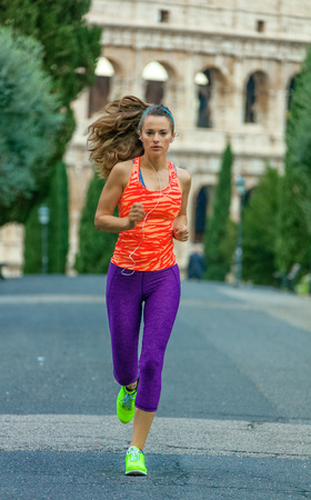 Gladiator inspiring trainings. young healthy woman in sportswear in Rome, Italy running Stock Photo