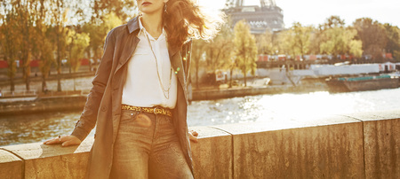 Autumn getaways in Paris. Closeup on young elegant woman in sunglasses on embankment in Paris, France looking into the distance