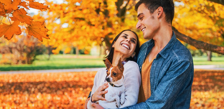 Portrait of happy young couple outdoors in autumn