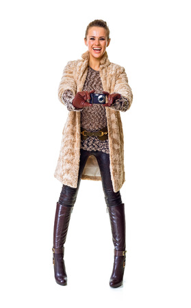 Winter things. happy stylish fashion-monger in winter coat isolated on white with digital camera taking photo Stock Photo