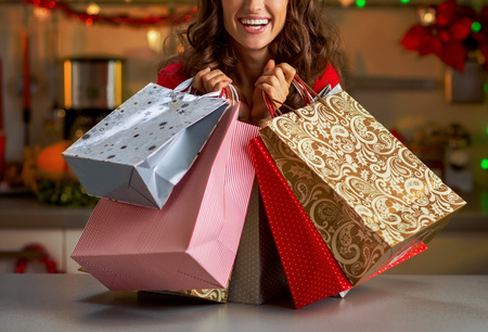 Smiling young woman with christmas shopping bags in christmas