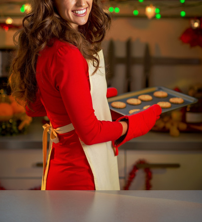 Happy young housewife with pan of christmas cookies Reklamní fotografie