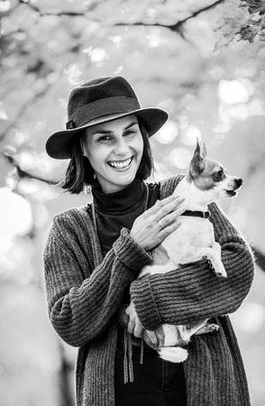 blackwhite: Portrait of happy young woman dog outdoors in autumn