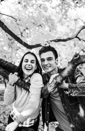 Portrait of smiling young couple outdoors in autumn Stock Photo
