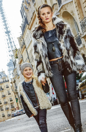 Boiling hot trendy winter in Paris. modern mother and daughter in Paris, France going forward