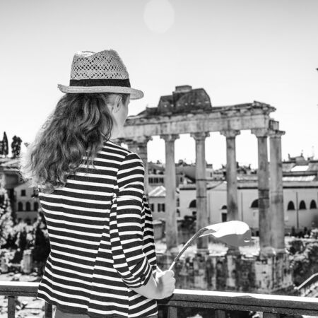 Roman Holiday. Seen from behind trendy woman in Rome, Italy showing Italian flag
