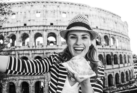 Roman Holiday. happy young tourist woman in Rome, Italy with pizza slice taking selfie