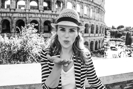 Roman Holiday. smiling trendy traveller woman in Rome, Italy blowing air kiss Stok Fotoğraf