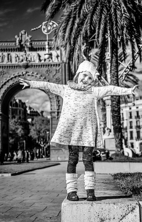 in Barcelona for a perfect winter. Full length portrait of happy trendy girl in Barcelona, Spain rejoicing Stock Photo