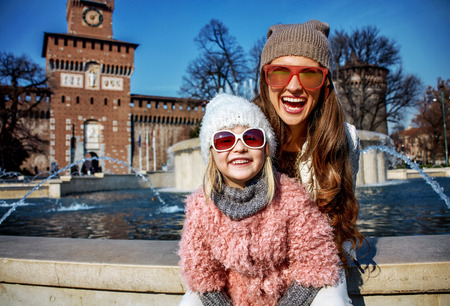 Rediscovering things everybody love in Milan. Portrait of happy modern mother and daughter tourists in sunglasses near Sforza Castle in Milan, Italy