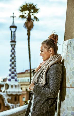 Barcelona signature style. Portrait of happy elegant woman in Barcelona, Spain in the winter Stock Photo
