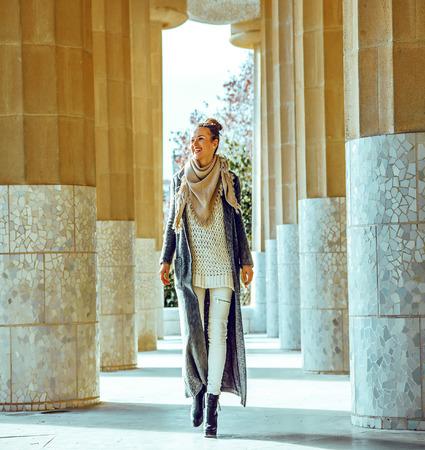 Barcelona signature style. happy stylish woman in Barcelona, Spain in the winter walking