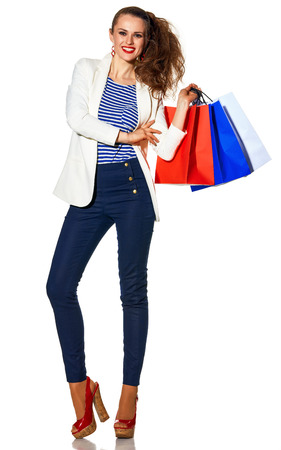Luxury Shopping. The French way. Full length portrait of smiling young fashion-monger in white jacket isolated on white background with shopping bags painted in the color of the French flag